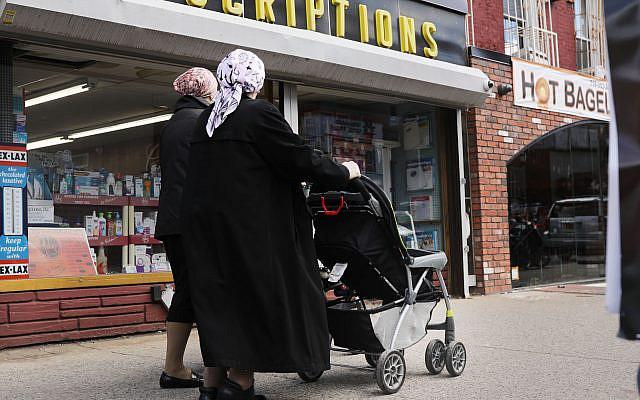 Illustrative: Orthodox Jewish women walking in the Williamsburg neighborhood of Brooklyn, April 10, 2019. (Spencer Platt/Getty Images via JTA)