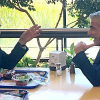 Yisrael Beytenu leader Avidgor Liberman (L) talks with then-Blue and White No. 2 Yair Lapid in the cafeteria of the Knesset on October 3, 2019. (Raoul Wootliff/Times of Israel)