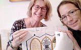 Lili Shain (left) teaches Liat Bartal how to cross-stitch. (Courtesy of Lili Shain)