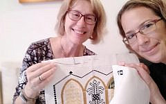 Lili Shain (left) teaches Liat Bartal how to cross-stitch. (Courtesy of Lili Shain)