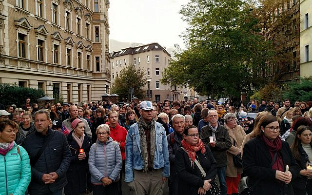 People gather in candle light vigil in front of the synagogue in Halle, Germany, October 11, 2019. (Yaakov Schwartz/ Times of Israel)