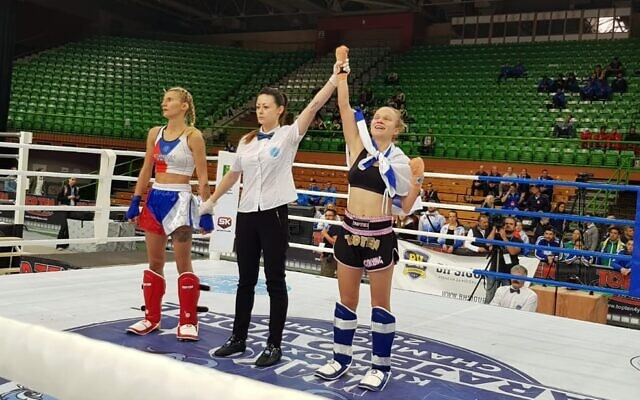 Yulia Sachkov (R) celebrates after winning a gold medal at the world kickboxing championships in Sarajevo, Bosnia, October 26, 2019. (Ayelet Federation on Non-Olympic Sport in Israel)