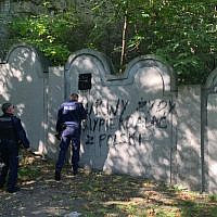 Vandals painted a swastika and anti-Semitic slur on one of the remaining walls of the former Krakow Ghetto on Oct. 1, 2019. (Courtesy of Jonathan Ornstein via JTA)