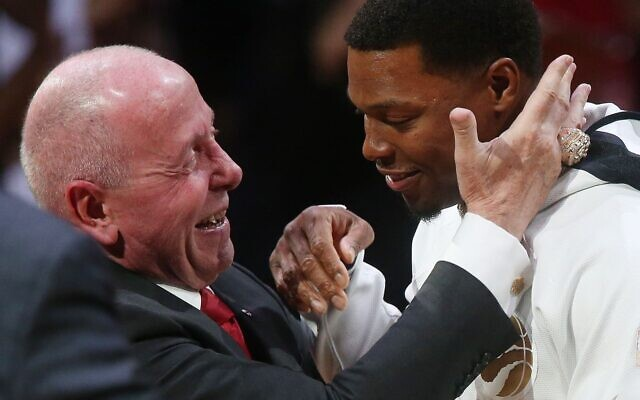 Toronto Raptors co-owner Larry Tanenbaum presents point guard Kyle Lowry with his championship ring prior to the NBA team's season opener, October 22, 2019. (Steve Russell/Toronto Star via Getty Images via JTA)