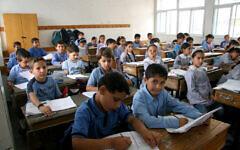 Palestinian schoolchildren studying at an UNRWA school in Gaza City. (IRIN/Creative Commons via JTA)