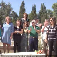 Descendants of Jews saved by Oskar Schindler gather at his gravesite in Jerusalem on October 7, 2019 (Channel 13 screenshot)
