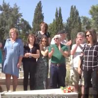 Descendants of Jews saved by Oskar Schindler gather at his gravesite in Jerusalem on October 7, 2019 (Channel 13 screenshot)