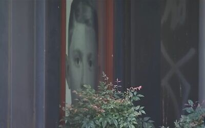 Screen capture from video of alleged white supremacist graffiti discovered sprayed on The Holocaust Center for Humanity in Seattle, October 2019. (YouTube)