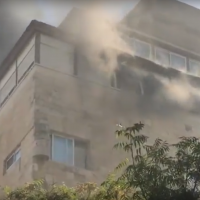 A fire in an apartment on Ben Yehuda Street in central Jerusalem, October 16, 2019. (Screenshot: YouTube)