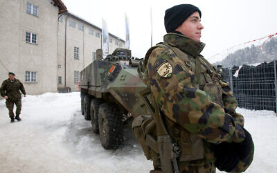 Illustrative: Soldiers guard a power plant near Kueblis, Switzerland, Jan. 27, 2009. (AP Photo/Keystone, Ennio Leanza)