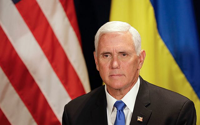 US Vice President Mike Pence waits before a meeting with Ukraine's President Volodymyr Zelensky, in Warsaw, Poland, September 1, 2019. (AP Photo/Petr David Josek)