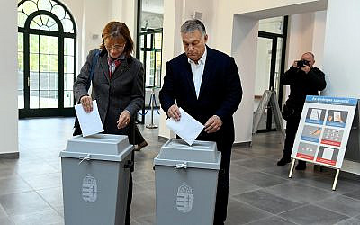 Hungarian Prime Minister Viktor Orban of the governing Fidesz party and his wife cast their ballots during local elections in Budapest, Hungary, October 13, 2019. (Szilard Koszticsak/MTI via AP)