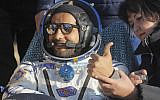 United Arab Emirates astronaut Hazzaa al-Mansoori gestures shortly after the landing in a space capsule about 150 km (90 miles) south-east of the Kazakh town of Dzhezkazgan on October 3, 2019. (Dmitri Lovetsky/Pool/AFP)
