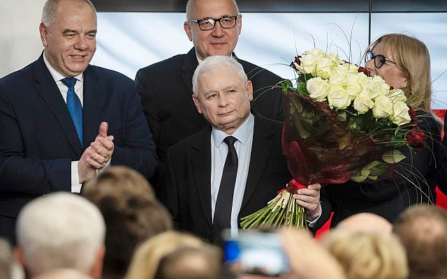 Leader of Poland's ruling party Jaroslaw Kaczynski, center, and party activists react to exit poll results after voting closed in the nation's parliamentary election in Warsaw , Poland, October 13 ,2019. (AP Photo)