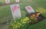 Vandalized graves in a Commonwealth military cemetery in Haifa, October 11, 2019. (Israel police)