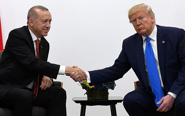 US President Donald Trump, right, shakes hands with Turkish President Recep Tayyip Erdogan, left, during a meeting on the sidelines of the G-20 summit in Osaka, Japan, June 29, 2019. (AP Photo/Susan Walsh)
