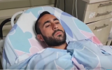 Elazar Hazut, who was wounded by a lightning strike speaks to reporters from his hospital bed at the Barzilai medical center on October 15, 2019. (Screen capture/Ynet)