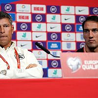 Bulgaria's manager Krasimir Balakov, left, with captain Ivelin Popov, right, attenda a press conference at Wembley Stadium, London, Sept. 6, 2019. (John Walton/PA via AP)