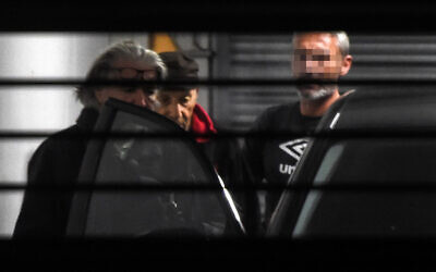 Claude Sinke (R), the octogenarian accused of wounding two men in a shooting at a mosque in southern France and his lawyer Benoit Briffe (L) enter a police car before leaving the Bayonne courthouse on October 30, 2019 where Sinke was charged and ordered held in detention. (Gaizka Iroz/AFP)