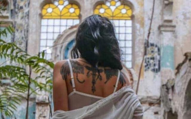A model in a dilapidated Romanian synagogue. (Edy Rosen/Facebook via JTA)