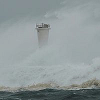 Surging waves hit against the breakwater and a lighthouse as Typhoon Hagibis approaches at a port in town of Kiho, Mie prefecture, central Japan, October 12, 2019. (AP Photo/Toru Hanai)