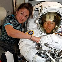 In this image released by NASA on October 4, 2019, astronauts Christina Koch, right, and, Jessica Meir, left, pose on the International Space Station. (NASA via AP)