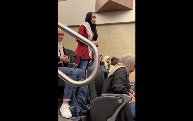 Ayah Ali speaking at Benedictine University in Lisle, Ill. (Screenshot/Benedictine SJP/Twitter via JTA)