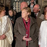 German Chancellor Angela Merkel, center, stands with Rabbi Gesa S. Ederberg, left, and other members of the Jewish community at a vigil outside the New Synagogue in Berlin on October 9, 2019. (Anton Roland Laub/AFP)