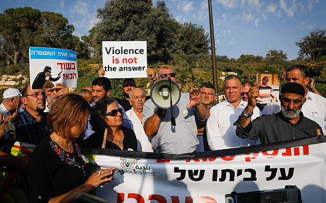 Arab Israelis and supporters demonstrate in front of the prime minister's office in Jerusalem, demanding government action to curb criminal violence in their communities, October 10, 2019. (Yonatan Sindel/Flash90)