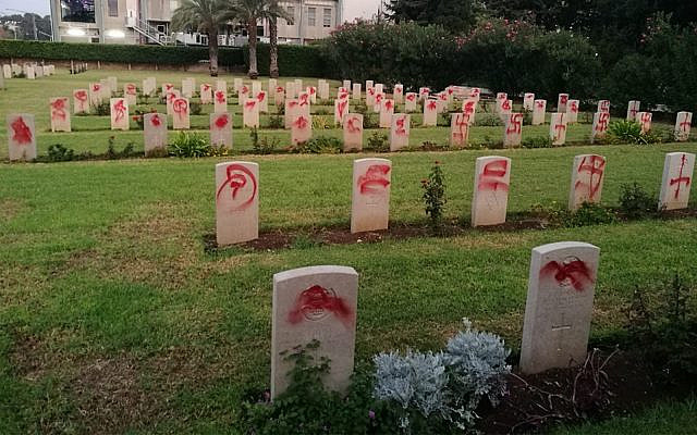 Vandalized graves in a British military cemetery in Haifa, October 11, 2019. (Commonwealth War Graves Commission)