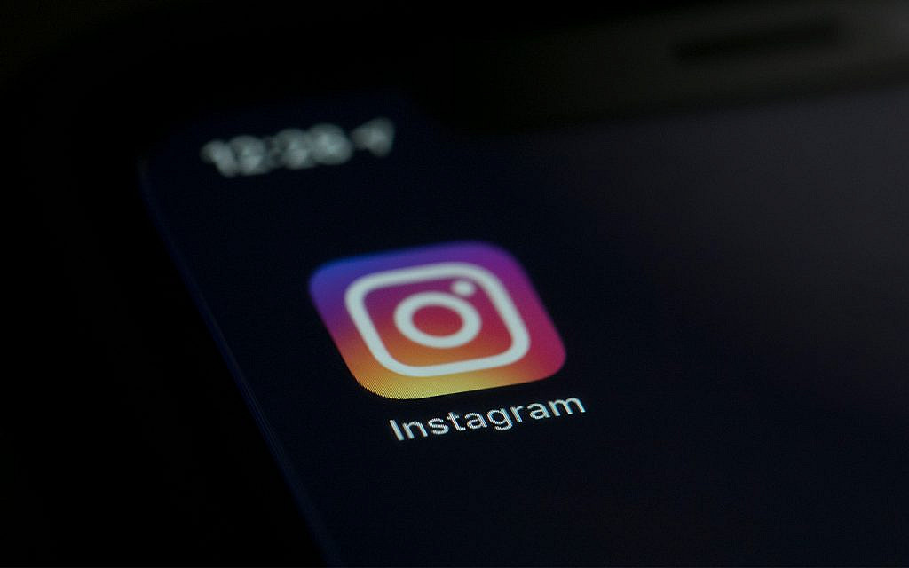 Illustrative: the Instagram app icon on the screen of a mobile device in New York, August 23, 2019. (AP Photo/Jenny Kane)