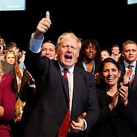 UK Prime Minister Boris Johnson gives a thumb up after Sajid Javid, Chancellor of the Exchequer, delivered his speech at the Conservative Party Conference in Manchester, England, September 30, 2019.(AP Photo/Frank Augstein)