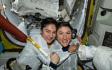 US astronauts Jessica Meir, left, and Christina Koch, right, pose for a photo in the International Space Station, October 18, 2019. (NASA via AP)