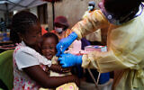 A child is vaccinated against Ebola in Beni, DRC, July 13, 2019. (AP Photo/Jerome Delay, file)