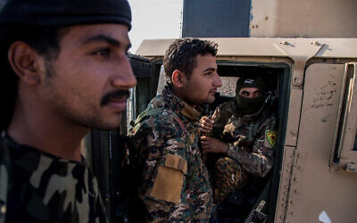 Kurdish forces withdraw from from an area near the Turkish border with Syria near the town of Amuda, October 27, 2019. (AP Photo/Baderkhan Ahmad)
