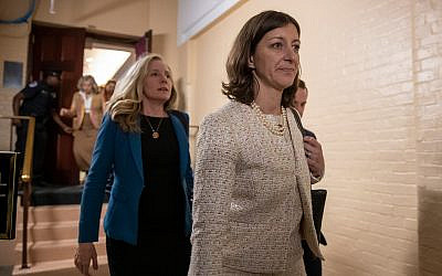 Representative Elaine Luria, right, followed by Representative Abigail Spanberger, left, leave a House Democratic Caucus meeting with Speaker of the House Nancy Pelosi where she was persuaded to launch a formal impeachment inquiry against US President Donald Trump, at the Capitol in Washington, September 24, 2019. (AP Photo/J. Scott Applewhite)