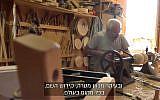 A worker in Kibbutz Lavi's carpentry factory. (Screenshot/Channel 13)