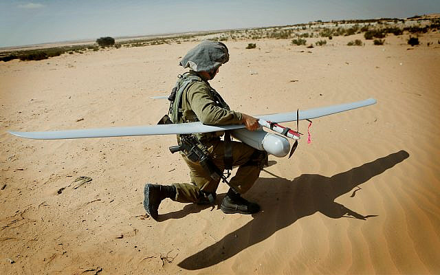 An IDF soldier with a Skylark drone during a drill at the Tzelim army base, August 5, 2013. (Miriam Alster/Flash90)