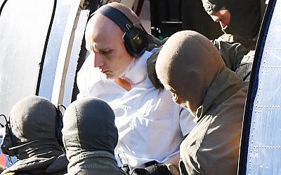 Stephan Balliet, the suspect in the Halle shooting, gets out of a helicopter at the Federal Supreme Court in Karlsruhe, southern Germany, October 10, 2019. (Uli Deck/dpa/AFP)