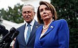 House Speaker Nancy Pelosi of California, right, speaks with members of the media alongside Senate Minority Leader Senator Chuck Schumer of New York after a meeting with US President Donald Trump, October 16, 2019, in Washington. (AP Photo/Patrick Semansky)