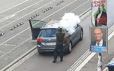 An armed man fires on a street in Halle, Germany, following a shooting outside a synagogue in that city which killed two. (Screenshot/Andreas Splett/ATV-Studio Halle/AFP)