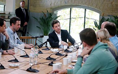 Ukrainian President Volodymyr Zelensky speaks with journalists in Kyiv, Ukraine, October 10, 2019. (AP Photo/Efrem Lukatsky)