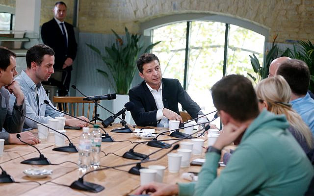 Ukrainian President Volodymyr Zelensky speaks with journalists in Kyiv, Ukraine, October 10, 2019. (AP Photo/Efrem Lukatsky)