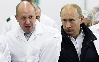 Russian businessman Yevgeny Prigozhin, left, shows Russian President Vladimir Putin, right, around his factory outside St. Petersburg, Russia, September 20, 2010. (Alexei Druzhinin/Pool Photo via AP, File)