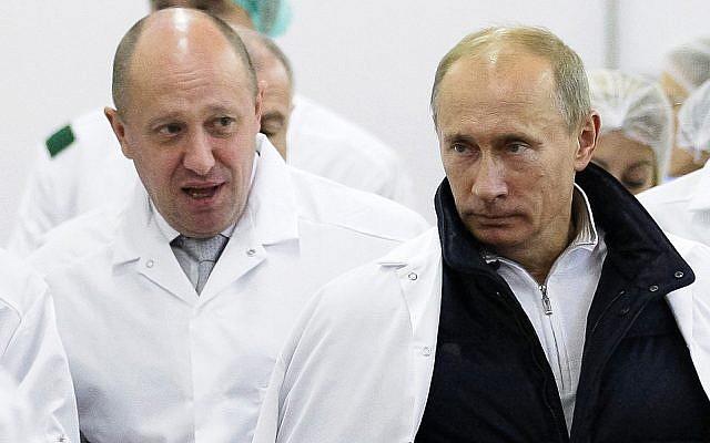 Russian businessman Yevgeny Prigozhin, left, shows Russian President Vladimir Putin, right, around his factory outside St. Petersburg, Russia, September 20, 2010. (Alexei Druzhinin/Pool Photo via AP, File)