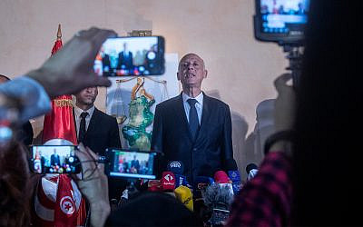 Tunisian presidential candidate and law professor Kais Saied speaks to the reporters and supporters, October 13, 2019 in Tunis. (AP Photo/Mosa'ab Elshamy)