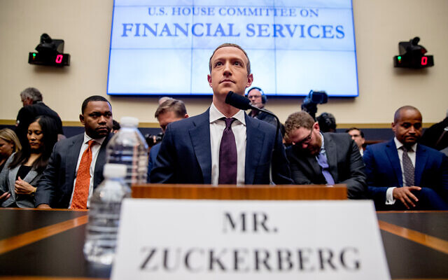 Facebook CEO Mark Zuckerberg arrives for a House Financial Services Committee hearing on Capitol Hill in Washington, October 23, 2019, on Facebook's impact on the financial services and housing sectors. (AP Photo/Andrew Harnik)