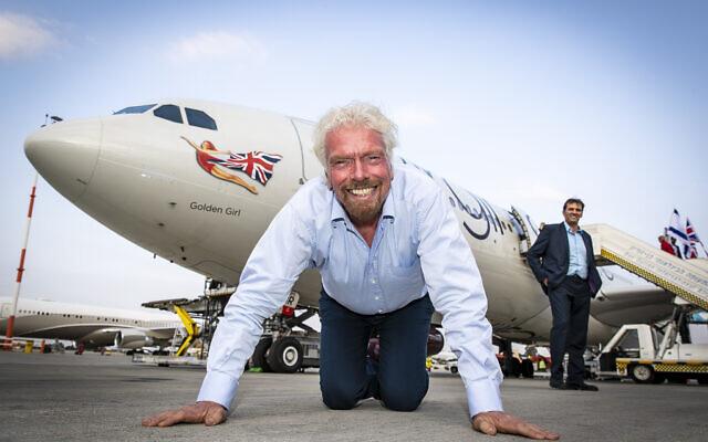 Virgin Atlantic founder Richard Branson kisses the ground as he touches down at Ben Gurion Airport in Tel Aviv, Israel.    (Courtesy Virgin)