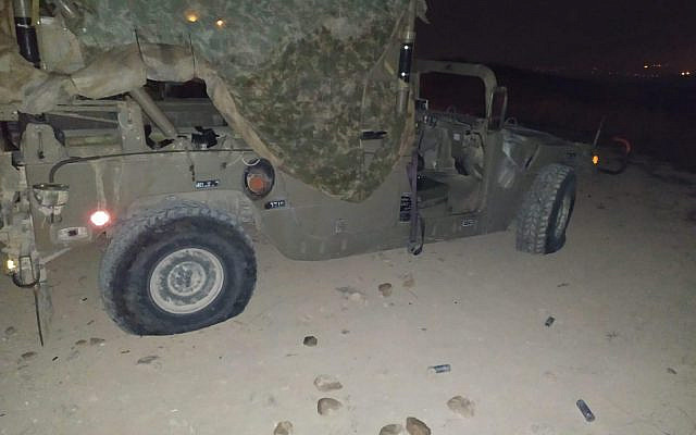 A military jeep is damaged in riots by settlers near the West Bank settlement of Yitzhar on October 20, 2019 (Courtesy)