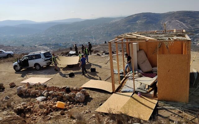 Civil Administration workers demolish two structures in the Shevah Ha'aretz illegal outpost near Yitzhar on October 24, 2019. (Courtesy)